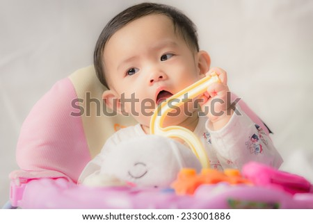 Asian adorable baby girl with toy