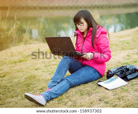 Asian adult student sitting outdoor