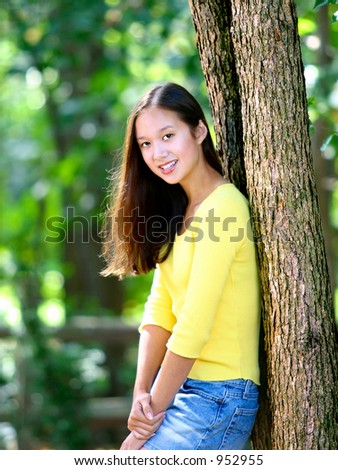 asian american teen posing in backyard - stock photo