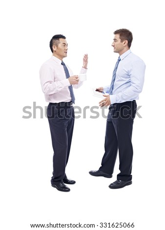 asian and caucasian corporate executives standing and talking, isolated on white background.