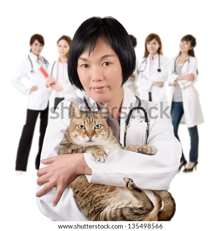 Asian animal doctor hold a cat and stand in front of her team at white background.