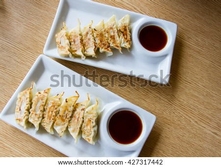 Asian appetizer menu fried dumplings with soy sauce Japanese tone - stock photo