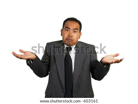 Asian / Asian-American / Filipino / Pilipino man in a business suit giving a shrug - stock photo