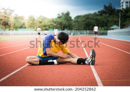 Asian athlete on the track