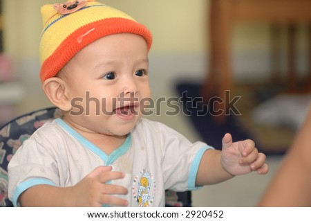 Asian baby boy laughing