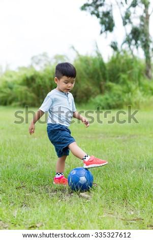 Asian Baby boy play soccer ball at park - stock photo