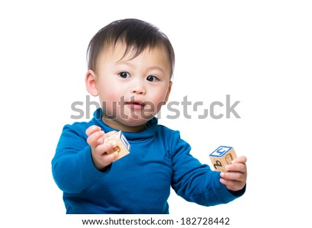 Asian baby boy play with toy block and isolated on white