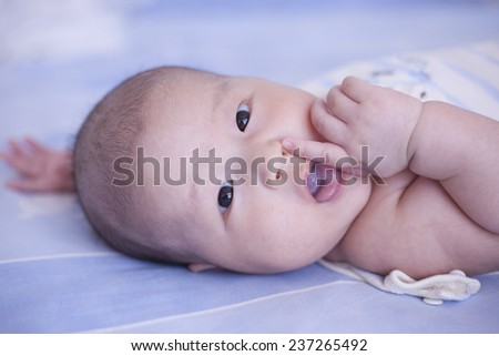 Asian baby boy put hand in mouth