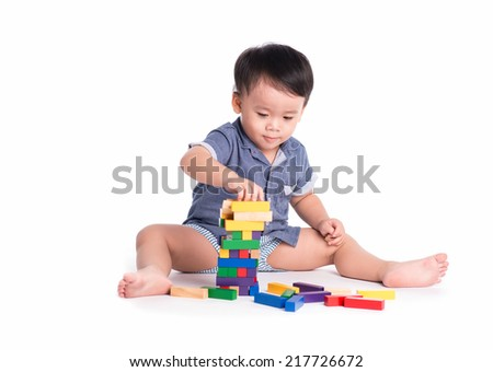 asian baby boy with construction set isolated on white background - stock photo