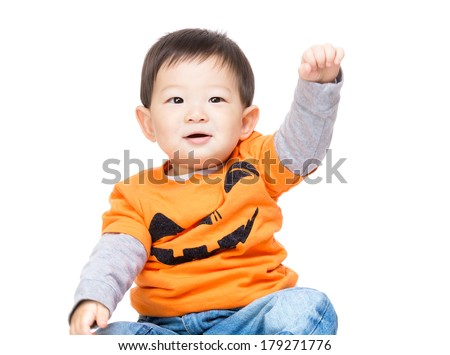 Asian baby boy with halloween dressing and hands up - stock photo