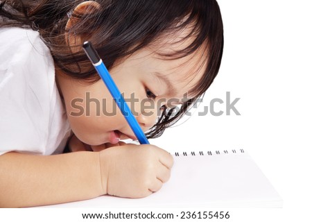 Asian baby concentrates to write a letter on a book isolated on white background - stock photo