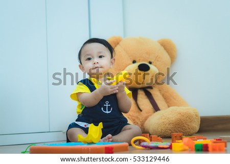 Asian baby cute boy with his toy