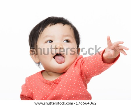 Asian baby gilr showing tongue and hand pointing front