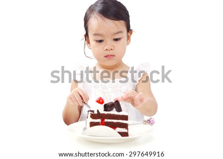 Asian Baby Girl Eating Chocolate Cake Isolated on White Background. - stock photo