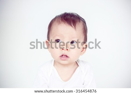 Asian baby girl smiling, studio shot (soft focus on the eyes) - stock photo