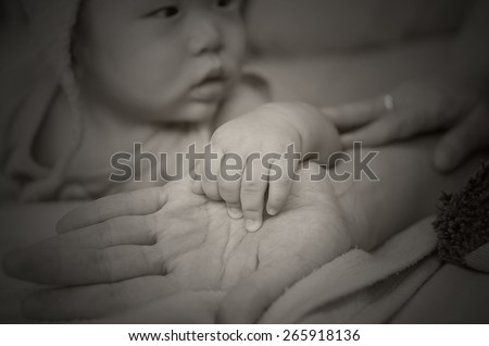 Asian baby hand on the mothers hand