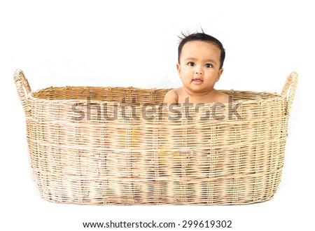 Asian baby in basket on white background