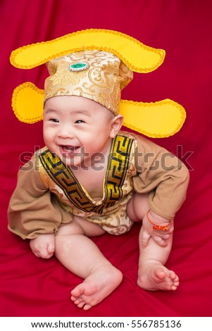 Asian baby in costume king of china cosplay
