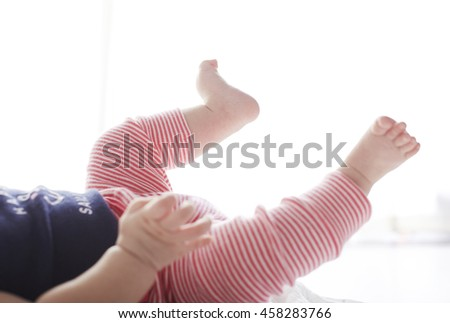 Asian baby,lying on the ground.Closeup of hands and feet