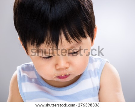 Asian baby son with dirty mouth - stock photo