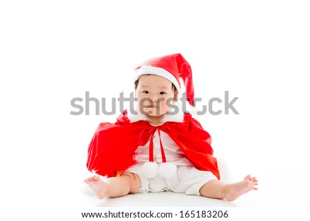 asian baby wearing santa costume on white background