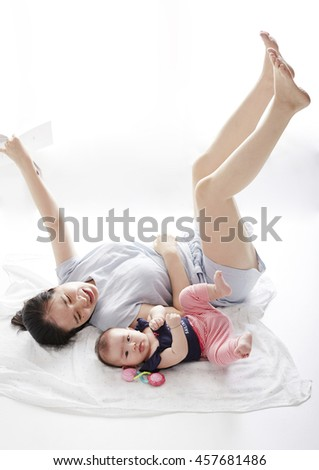 Asian baby with mother, parent-child communication