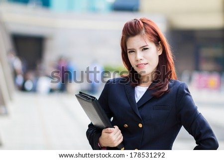 asian beautiful Businesswoman holding document file at outdoor office.