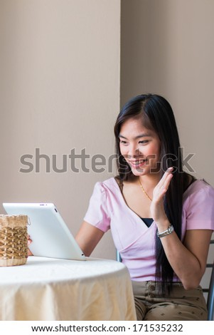 Asian beautiful women playing Tablets