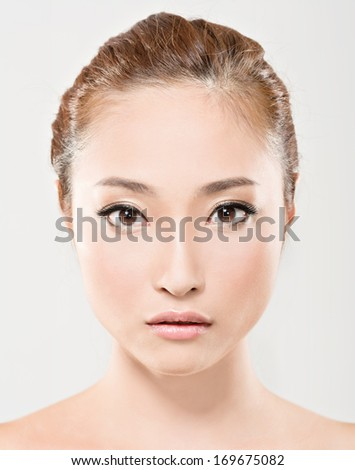 Asian beauty face closeup portrait with clean and fresh elegant lady. Studio shot. - stock photo