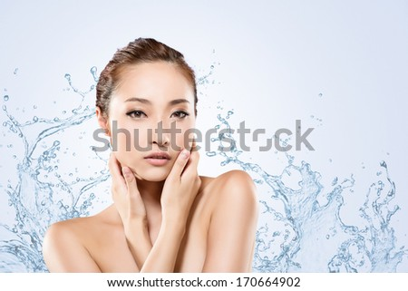 Asian beauty face with water, closeup portrait with clean and fresh elegant lady. - stock photo