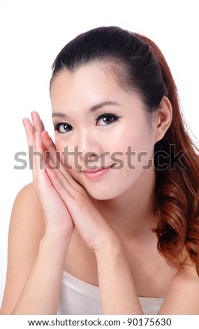 Asian beauty skin care Girl smiling close-up, Beautiful young woman touching her face looking to the side. Isolated on white background - stock photo