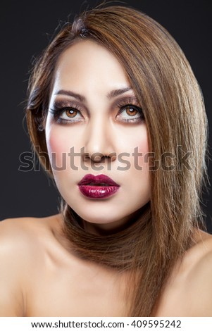 Asian beauty with perfect skin and dark makeup