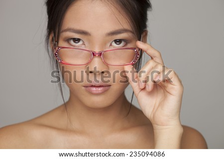 Asian beauty woman skin care close-up. Glasses in hand - stock photo