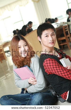 asian boy and girl in library