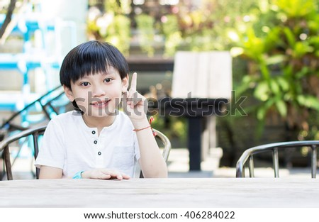 Asian boy comes up with ideas in park