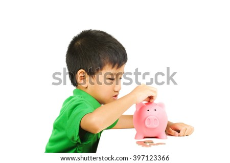 asian boy happy with piggy bank saving coins, white isolation background - stock photo