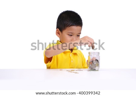 asian boy happy with saving coins, white isolation background - stock photo