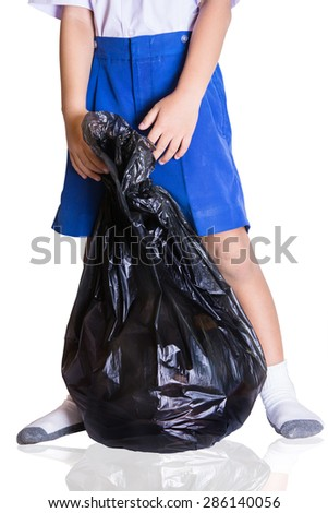 Asian Boy in Uniform hold  Black Bag on Isolated white background,With Clipping Path ,recycle Bag, Save the world concept - stock photo