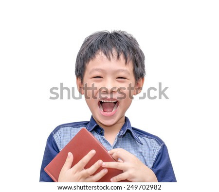 Asian boy laughing between reading a book over white background - stock photo