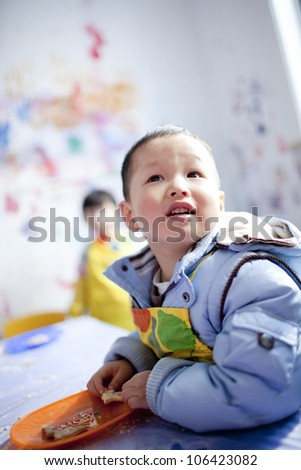 Asian boy learning the painting in the classroom,shanghai,china