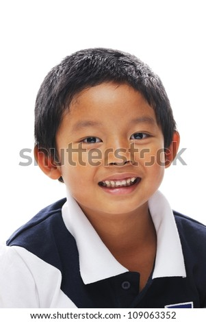 Asian boy looking at camera and looking happy