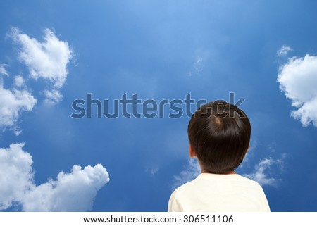 Asian boy  looking up. - stock photo