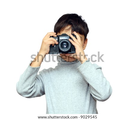 asian boy photographing with black slr camera isolated on white