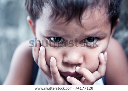 Asian boy portrait - Filipino child contemplating closeup, shallow depth of field - stock photo