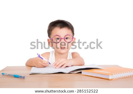asian boy student to do homework at a table isolate on a white background - stock photo