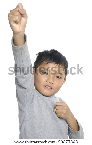 Asian boy with hand to success - stock photo