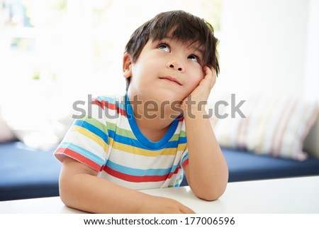Asian Boy With Head In Hands Thinking - stock photo