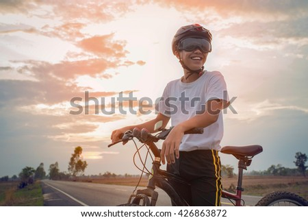 Asian boys enjoyed a cycling holiday. - stock photo