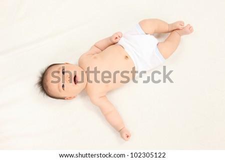 Asian boys lying white background - stock photo