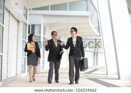 asian busines team outdoor meeting - stock photo